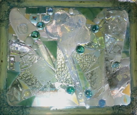 upcycled picture frame from a local yard sale. It has been turned into a glass-on-glass mosaic, with kiln-formed chunks of recycled glass epoxied on to the original glass.  The piece is approximately