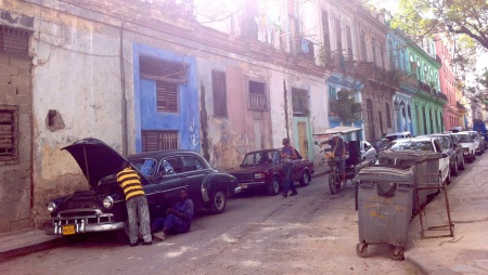 caring for an old car in old Havana