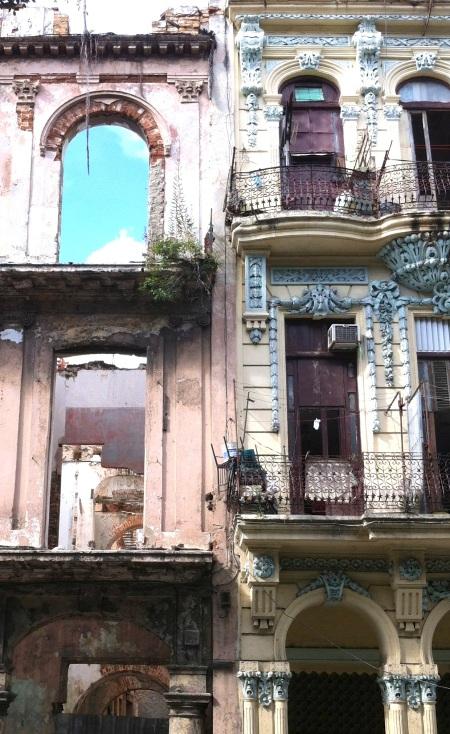 Restored building beside ruin