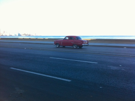 Red Car on the Malecon Havana